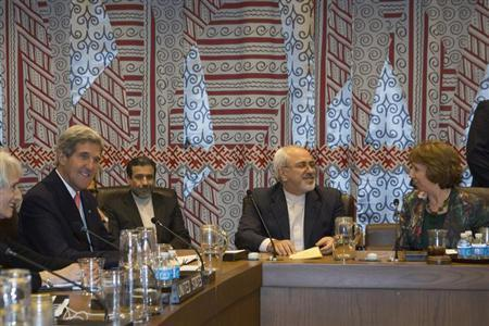 U.S. Secretary of State John Kerry (L), Iran's Foreign Minister Mohammad Javad Zarif (2nd R) and European Union High Representative Catherine Ashton (R) are seated during a meeting of the foreign ministers representing the permanent five member countries of the United Nations Security Council, including Germany, at UN Headquarters in New York September 26, 2013. REUTERS/Brendan McDermid