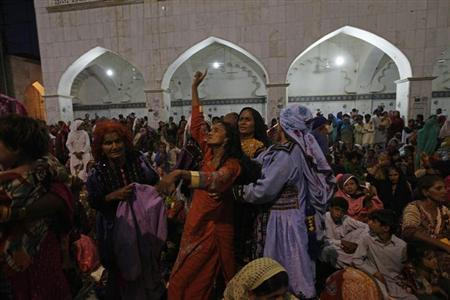 A woman devotee dances in trance to the beat of the drum at the tomb of Sufi saint Syed Usman Marwandi, also known as Lal Shahbaz Qalandar, in Sehwan Sharif, in Pakistan's southern Sindh province September 5, 2013. REUTERS/Akhtar Soomro