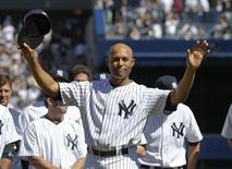 New York Yankees relief pitcher Mariano Rivera responds to the sold-out crowd during ceremonies honoring him before their MLB Interleague baseball game against the San Francisco Giants at Yankee Stadium in New York September 22, 2013. REUTERS/Ray Stubblebine