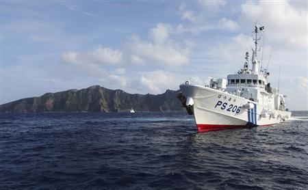 Japan Coast Guard vessel PS206 Houou sails in front of Uotsuri island, one of the disputed islands, called Senkaku in Japan and Diaoyu in China, in the East China Sea August 18, 2013. REUTERS/Ruairidh Villar