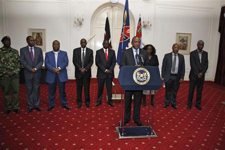 Kenya's President Uhuru Kenyatta, flanked by members of his cabinet, addresses the nation on the Westgate shopping mall attack in Nairobi September 24, 2013. REUTERS/Presidential Strategic Communications Unit/Handout via Reuters