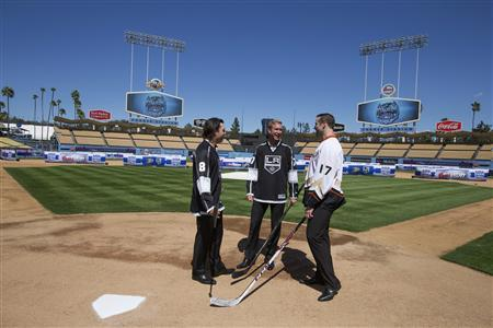 Los Angeles Kings' Drew Doughty (L-R), Jeff Carter, and Anaheim Ducks Dustin Penner chat after a news conference at Dodgers Stadium in Los Angeles, California, September 26, 2013. REUTERS/Lucy Nicholson