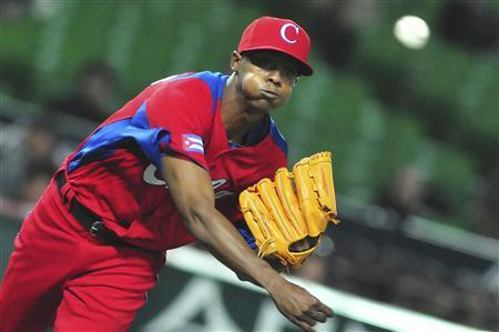 Cuba's Raicel Iglesias pitches a ball during the last preparation game for the World Baseball Classic (WBC) in Fukuoka in this March 1, 2013 file photo. REUTERS/AIN /Ricardo Lopez Hevia/GRANMA