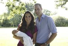 Britain's Prince William and his wife Catherine, Duchess of Cambridge, pose in the garden of the Middleton family home in Bucklebury, southern England, with their son Prince George, in this undated photograph released in London August 19, 2013. REUTERS/Michael Middleton/The Duke and Duchess of Cambridge/Handout via Reuters