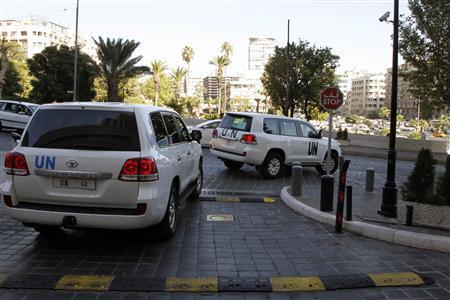 United Nations (U.N.) vehicles transport a team of U.N. chemical weapons experts in Damascus September 26, 2013. REUTERS/Khaled al-Hariri