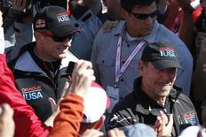 Oracle Team USA Skipper James Spithill (L) and Oracle CEO Larry Ellison walk pass spectators after the team successfully defended the 34th America's Cup yacht sailing race over Emirates Team New Zealand in San Francisco, California September 25, 2013. REUTERS/Stephen Lam