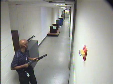 Aaron Alexis moves through the hallways of Building #197 carrying a Remington 870 shotgun in this undated handout photo released by the FBI. Over the course of an hour-long shooting incident at the Washington Navy Yard in Washington, DC on September 16, 2013, Aaron Alexis killed 12 people and wounded four others before he was shot and killed by law enforcement officers. REUTERS/FBI/Handout via Reuters