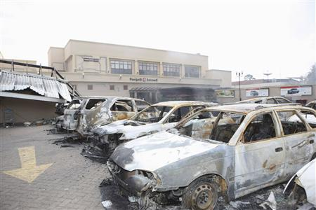 Wreckages of vehicles are seen within the destruction at the Westgate Shopping Centre in Nairobi, following a string of explosions during a stand-off between Kenyan security forces and gunmen inside the building in this handout picture provided by the Presidential Strategic Communications Unit September 26, 2013. REUTERS/Presidential Strategic Communications Unit/Handout via Reuters