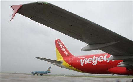 A VietJet A320 airplane is seen while parking before departure for Bangkok at Noi Bai international airport in Hanoi September 25, 2013. REUTERS/Kham