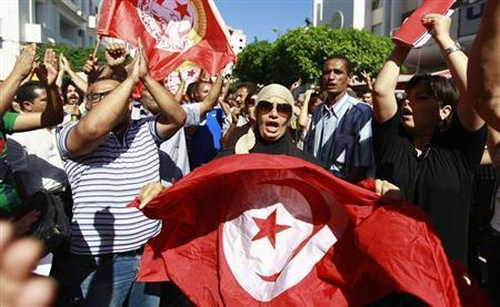 Anti-government protesters wave Tunisian flags as they rally for the dissolution of the Islamist-led government in Sfax, 170 miles (270 km) southeast of Tunis September 26, 2013. REUTERS/Anis Mili