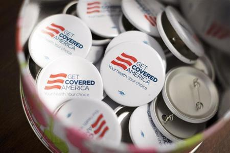 Get Covered America buttons are seen during a training session in Chicago, Illinois September 7, 2013 before volunteers canvas a Chicago neighborhood to talk with residents about the Affordable Care Act - also known as Obamacare. Picture taken September 7, 2013. REUTERS/John Gress