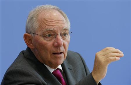 German Finance Minister Wolfgang Schaeuble gestures as he addresses a news conference to presents 2014 federal budget bill in Berlin June 26, 2013. REUTERS/Fabrizio Bensch