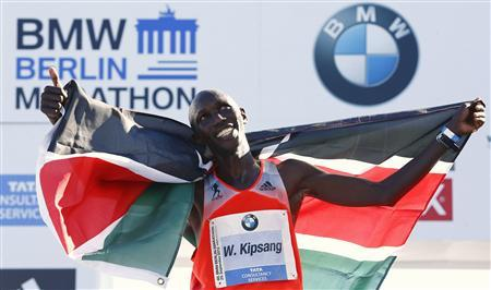 Wilson Kipsang of Kenya reacts after winning in the 40th Berlin marathon, September 29, 2013. REUTERS/Tobias Schwarz