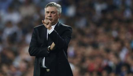 Real Madrid's coach Carlo Ancelotti gestures during their Spanish first division soccer match against Getafe at Santiago Bernabeu stadium in Madrid September 22, 2013. REUTERS/Javier Barbancho