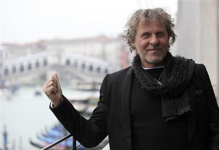 Founder of Diesel clothing company Renzo Rosso gestures as he poses in front of Rialto Bridge in Venice December 14, 2012. REUTERS/Manuel Silvestri