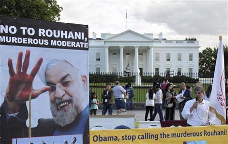 Iranian Americans protest against a conversation between U.S. President Barack Obama and new Iranian President Hassan Rouhani, outside the White House in Washington September 28, 2013. REUTERS/Yuri Gripas