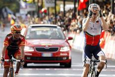Portugal's Rui Costa (R) celebrates as he crosses the finish to win the men's elite road race ahead of Spain's Joaquim Rodriguez at the UCI Road World Championships in Florence September 29, 2013. REUTERS/Giampiero Sposito