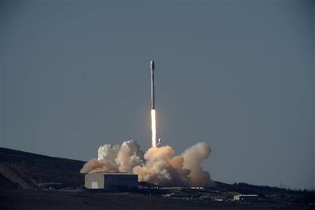 A Falcon 9 rocket carrying a small science satellite for Canada is seen as it is launched from a newly refurbished launch pad in Vandenberg Air Force Station September 29, 2013. REUTERS/Gene Blevins