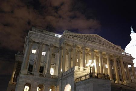 The U.S. House of Representatives remains fully lit during a rare late-night Saturday session at the U.S. Capitol in Washington, September 28, 2013. REUTERS/Jonathan Ernst