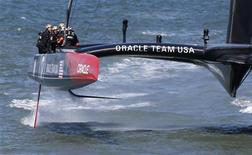 Members of the Oracle Team USA compete enroute to winning the overall title of the 34th America's Cup yacht sailing race over Emirates Team New Zealand in San Francisco, California September 25, 2013. REUTERS/Stephen Lam