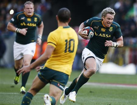 South Africa's Jean de Villiers breaks past Australia's Quade Cooper during their Rugby Championship match in Cape Town, September 28, 2013. REUTERS/Mike Hutchings