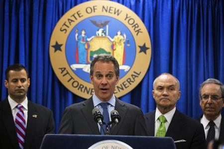 New York Attorney General Eric Schneiderman (C) speaks at a news conference announcing an organized crime task force take down of an unstamped cigarette trafficking ring in New York, May 16, 2013. REUTERS/Lucas Jackson