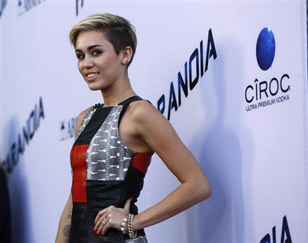 Singer Miley Cyrus poses at the premiere of ''Paranoia'' in Los Angeles, California August 8, 2013. The movie opens in the U.S. on August 16. REUTERS/Mario Anzuoni/Files