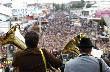 A brass band in traditional Bavarian clothes play instruments during the traditional concert at the 180th Oktoberfest beer festival in Munich September 29, 2013. REUTERS/Michaela Rehle