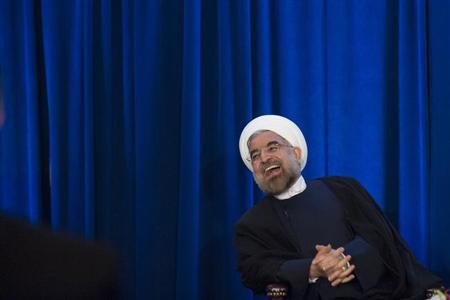 Iran's President Hassan Rohani laughs as he speaks during an event hosted by the Council on Foreign Relations and the Asia Society in New York, September 26, 2013. REUTERS/Keith Bedford