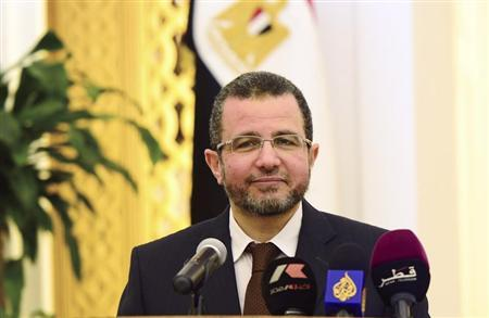 Egypt's Prime Minister Hisham Kandil speaks during a news conference with Qatari Prime Minister and Foreign Minister Sheik Hamad bin Jassim Al Thani (not pictured) at Diwam Emir in Doha, in this April 10, 2013 file photo. REUTERS/Stringer