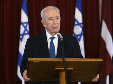 Israel's President Shimon Peres speaks during a news conference with his Latvian counterpart Andris Berzins (not pictured) in Riga July 29, 2013. REUTERS/Ints Kalnins