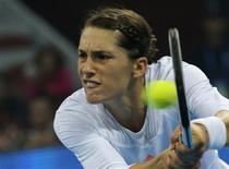 Andrea Petkovic of Germany hits a return against Victoria Azarenka of Belarus at the China Open tennis tournament in Beijing September 30, 2013. REUTERS/Kim Kyung-Hoon