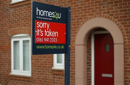 A sold board hangs outside a property in Altrincham, northern England July 3, 2013. REUTERS/Phil Noble