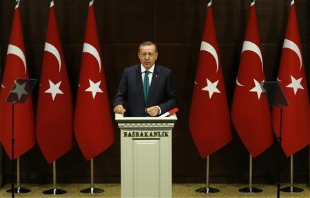 Turkish Prime Minister Tayyip Erdogan addresses the media in Ankara September 30, 2013. REUTERS/Umit Bektas
