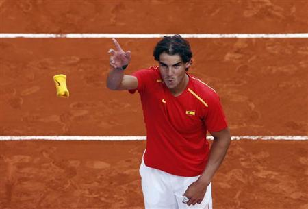 Spain's Rafael Nadal throws his wristband to the public after winning against Ukraine at the end of their Davis Cup World Group playoff tennis tie in Madrid September 14, 2013. REUTERS/Sergio Perez
