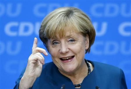 German Chancellor and leader of the Christian Democratic Union ( CDU) Angela Merkel, gestures during a news conference after a CDU party board meeting in Berlin September 23, 2013, the day after the general election. REUTERS/Kai Pfaffenbach