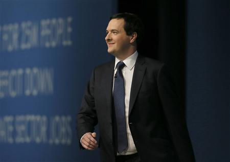 Britain's Chancellor of the Exchequer George Osborne takes to the stage to deliver his keynote speech at the annual Conservative party conference in Manchester, northern England September 30, 2013. REUTERS/Phil Noble