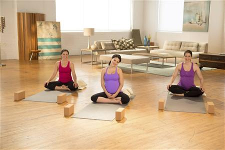 Yoga teacher and fitness expert Hilaria Baldwin (center) is shown during a prenatalyoga class in Brooklyn, N.Y. in this June 2013 handout photo taken from DVD. REUTERS/Acacia/Arthur Cohen/Handout via Reuters