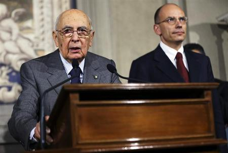 Italian President Giorgio Napolitano (L) speaks with reporters next to Prime Minister-designate and deputy leader of the centre-left Democratic Party (PD) Enrico Letta at the Quirinale Palace in Rome, April 27, 2013. REUTERS/Alessandro Bianchi