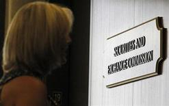 A woman waits for an elevator in the foyer of the Fort Worth Regional Office of the Securities and Exchange Commission (SEC) in Fort Worth, Texas June 28, 2012. REUTERS/Mike Stone