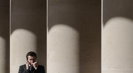 A city worker bites his nails outside the London Stock Exchange in Paternoster Square in the City of London at lunchtime October 1, 2008. REUTERS/Toby Melville