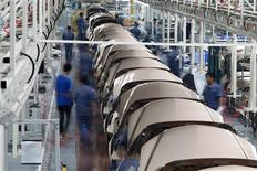 Employees work along a Geely Automobile Corporation assembly line in Cixi, Zhejiang province in this June 21, 2012 file photo. REUTERS/Carlos Barria/Files