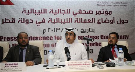 Chairman of the Qatar National Human Rights Committee Ali Bin Samikh Al-Marri (C) speaks next to the head of the Nepalese community in Qatar Macksud Alam and Mohammed Ramazan Ali (R), legal advisor for the Nepali nationals in Doha, during a news conference for the Nepalese community and Nepalese workers in Qatar, in Doha September 30, 2013. REUTERS/Fadi Al-Assaad