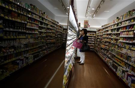 A customer looks at food products at a supermarket in Chiba, east of Tokyo September 30, 2013. REUTERS/Yuya Shino