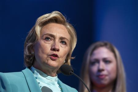 Former U.S. Secretary of State Hillary Clinton (L) speaks about a commitment to stop poaching of African elephants, as daughter Chelsea looks on, at the Clinton Global Initiative (CGI) in New York September 26, 2013. REUTERS/Lucas Jackson