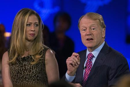 John Chambers, chairman and CEO of Cisco speaks in front of Chelsea Clinton at the Clinton Global Initiative (CGI) in New York September 25, 2013. REUTERS/Lucas Jackson