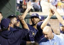 Sep 30, 2013; Arlington, TX, USA; Tampa Bay Rays starting pitcher David Price (middle) is welcomed back to the dugout after retiring the Texas Rangers during the eighth inning at Rangers Ballpark at Arlington. Mandatory Credit: Tim Heitman-USA TODAY Sports