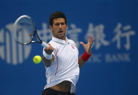 Serbia's Novak Djokovic returns a shot during his match against Lukas Rosol of the Czech Republic at the China Open tennis tournament in Beijing October 1, 2013. REUTERS/Petar Kujundzic