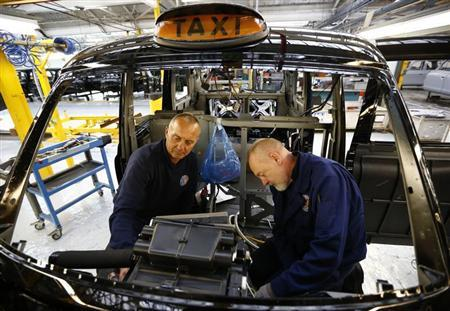 Men work on the production line at the London Taxi Company in Coventry, central England, September 11, 2013. REUTERS/Darren Staples