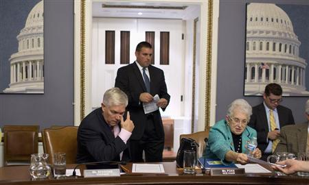 Chairman of the House Rules Committee, Representative Pete Session (L) (R-TX) and Representative Virginia Foxx (R-NC) sit after a late-night meeting at the U.S. Capitol in Washington, September 30, 2013. REUTERS/Joshua Roberts